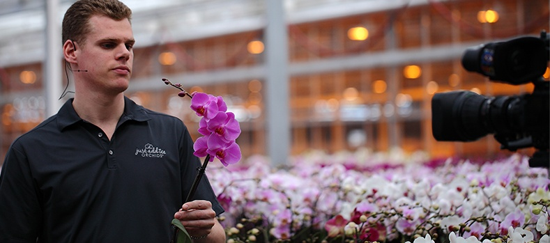 Man holding an orchid